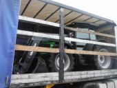 Deutz Fahr 95 c.w. loader being collected for delivery to Latvia